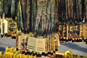 lanyards with medals featuring wine stoppers are collected to give to race finishers
