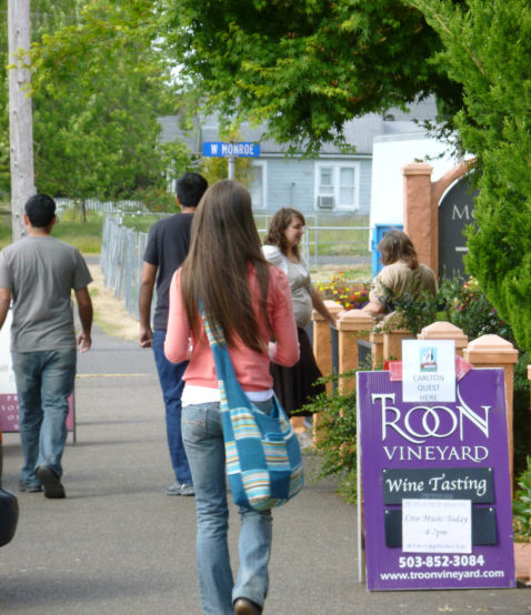 A woman walks towards a wine tasting bar at Troon Vineyard